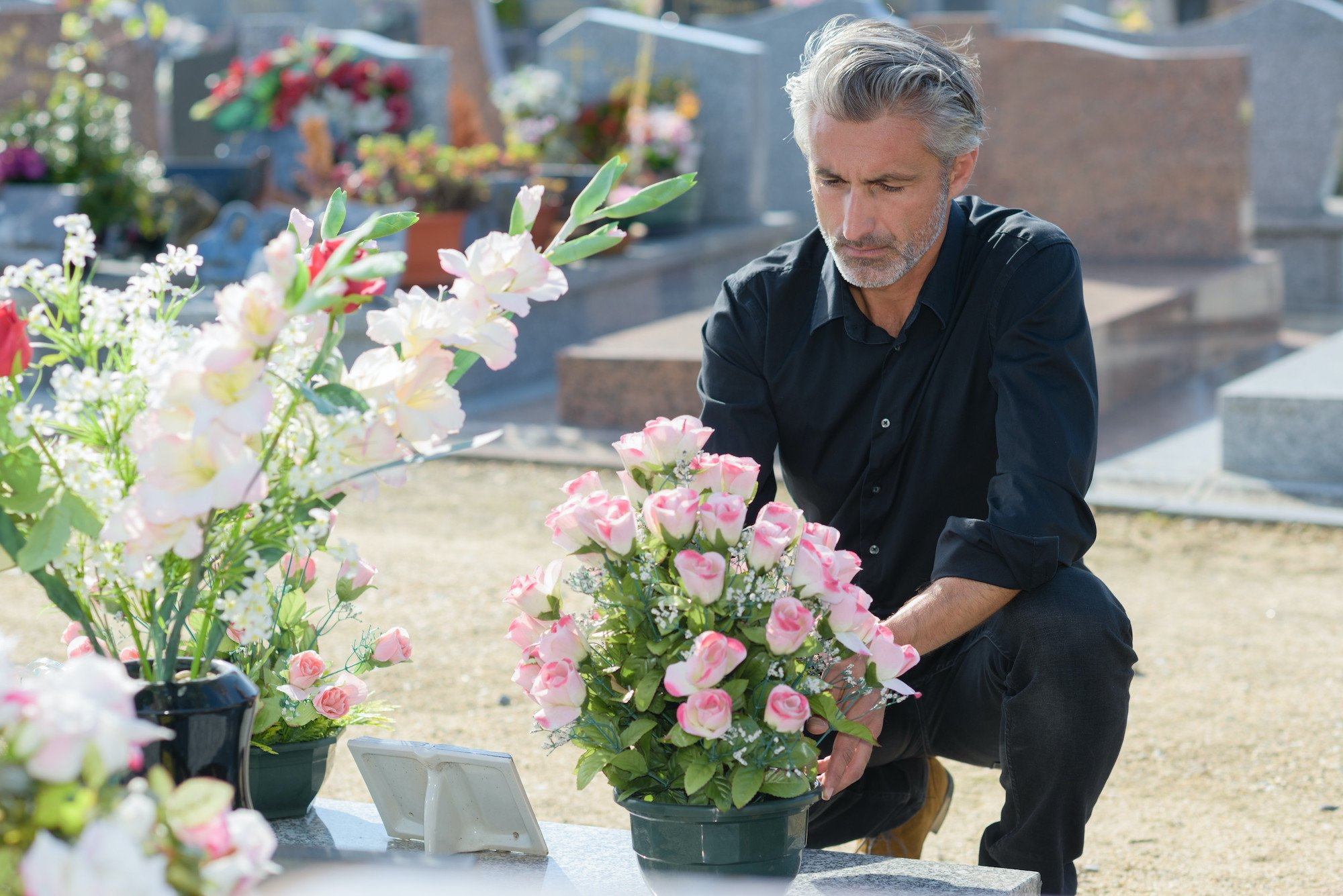 Man Mourning at Grave